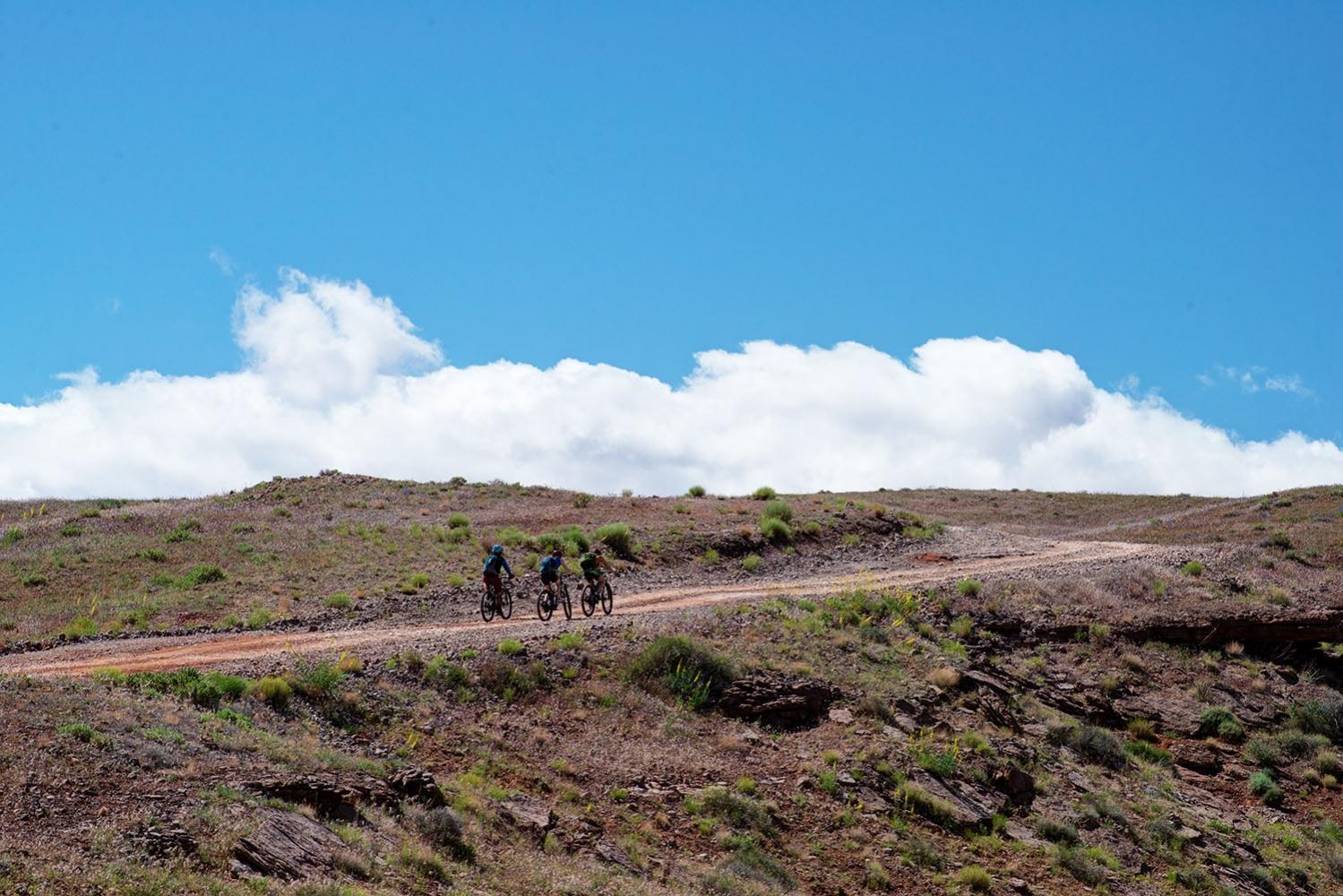 Canyonlands-National-Park-Full-Day-Guided-Mtb-Tour-Climbing-Toward-Horizon-Cloud
