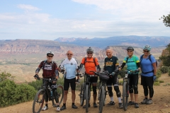 A group poses along the Rainbow Rim Trail