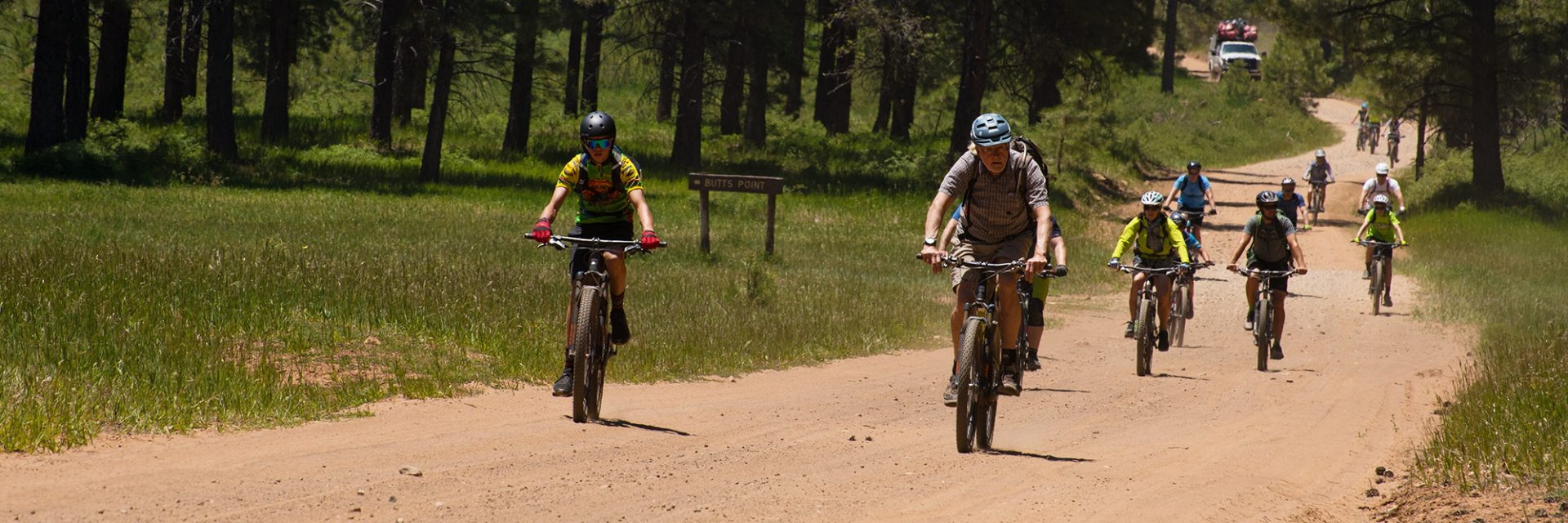 Mountain Bikers pass the road to Butts Point on the Bears Ears tour