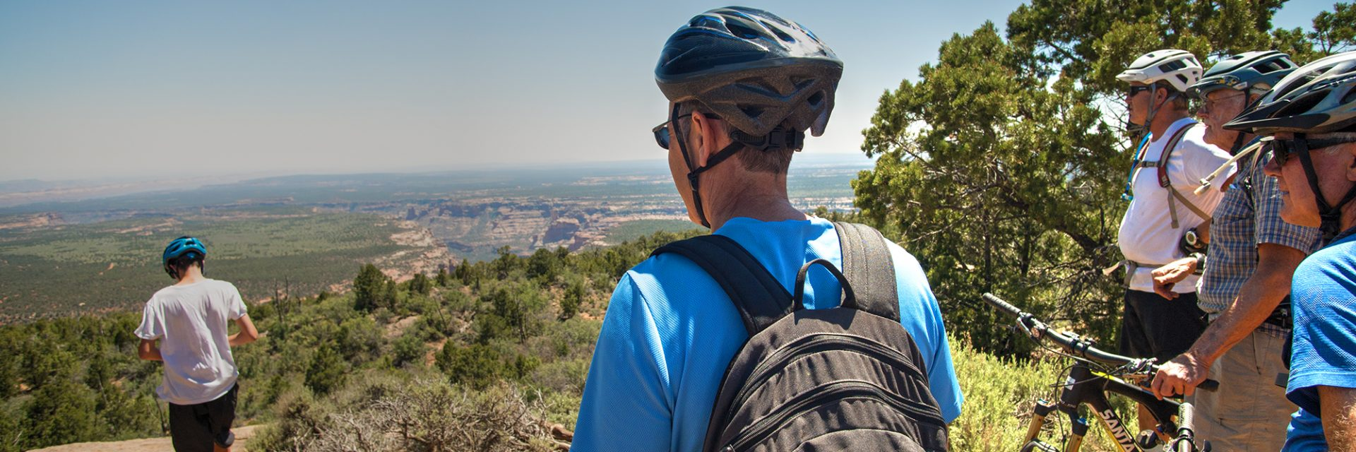 Riders on the Bears Ears tour stop at the Milk Ranch Road Overlook