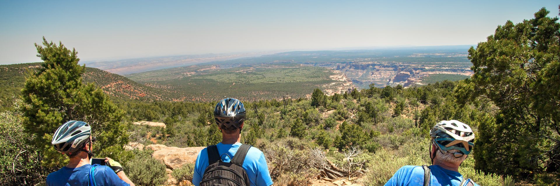 The Milk Ranch Road Overlook gives Bears Ears riders a view into Arch Canyon with Comb Ridge in the distance