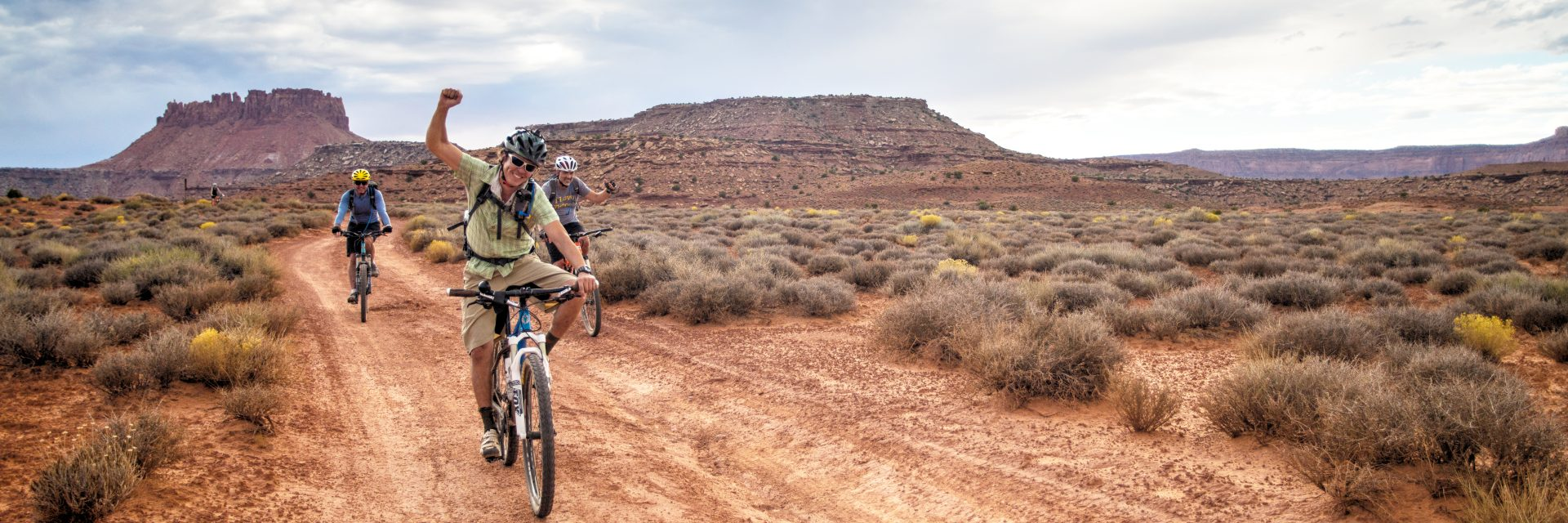 Cheers go up at the sight of camp, after a full day's ride into The Maze District, Canyonlands National Park on this guided mountain bike tour