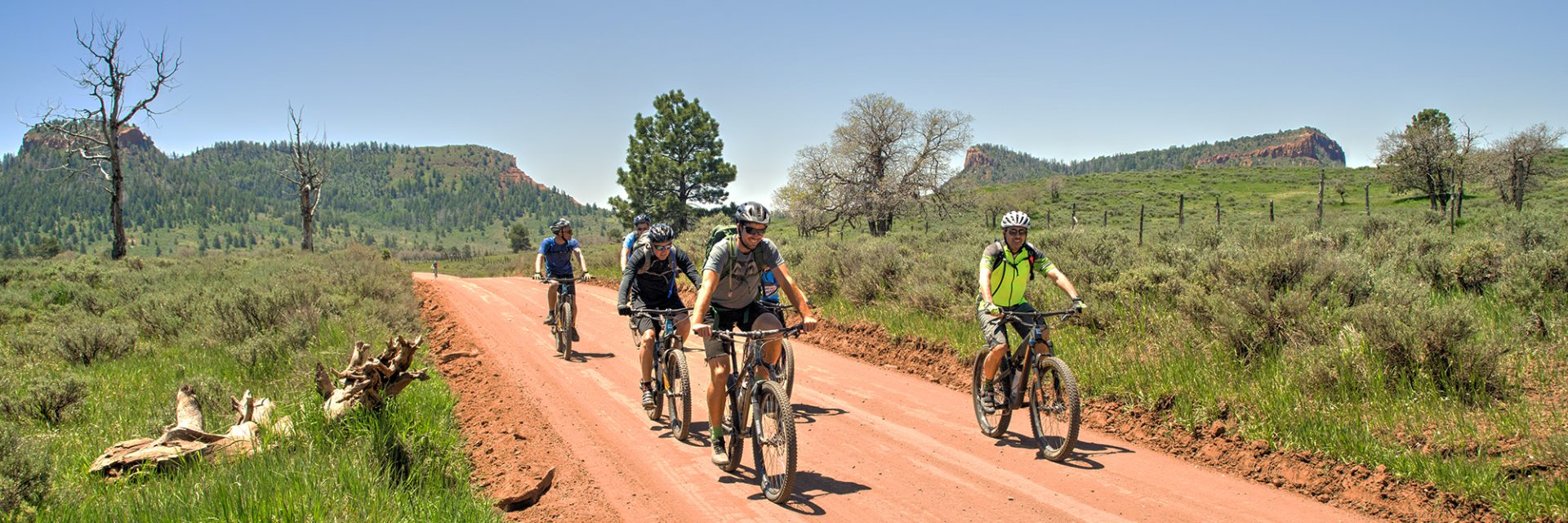 Mountain Bikers leave Bears Ears Buttes, East and West, behind heading north
