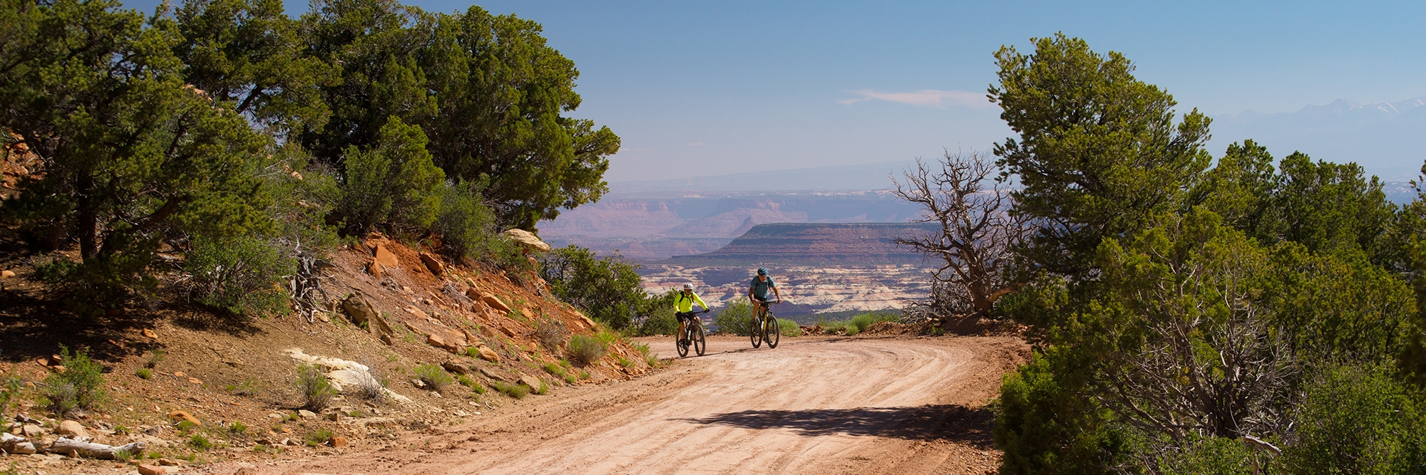 Riders on the Bears Ears tour begin the descent toward Cathedral Butte