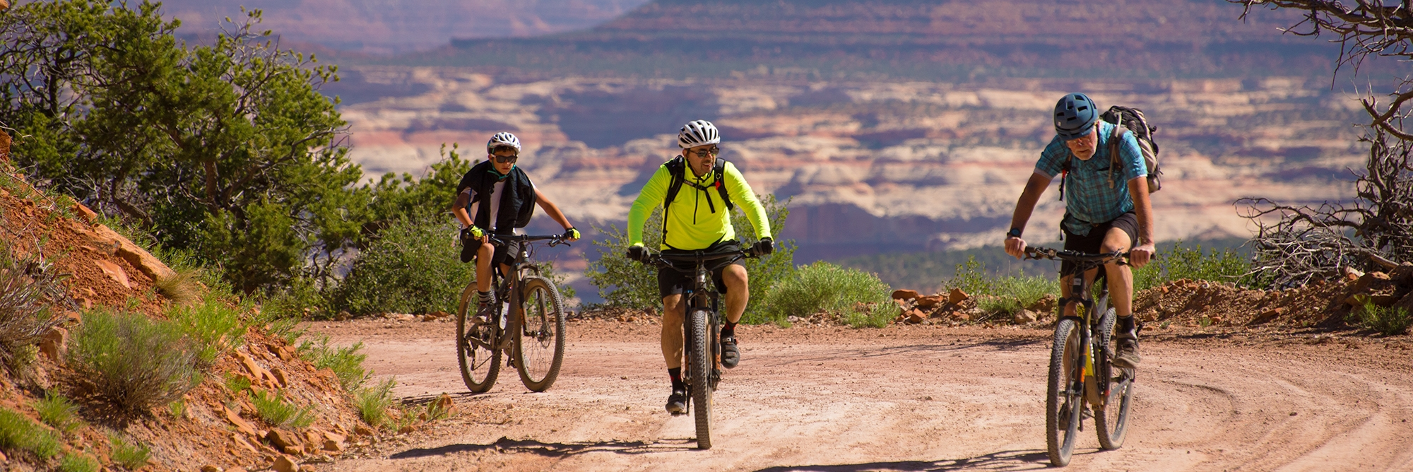 Bears Ears riders follow their guide on the Day 3 descent toward Cathedral Butte