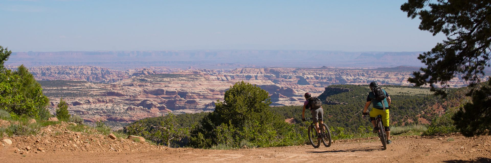 A rider on Bears Ears tour follows a guide down past Boundary Butte on Day 3