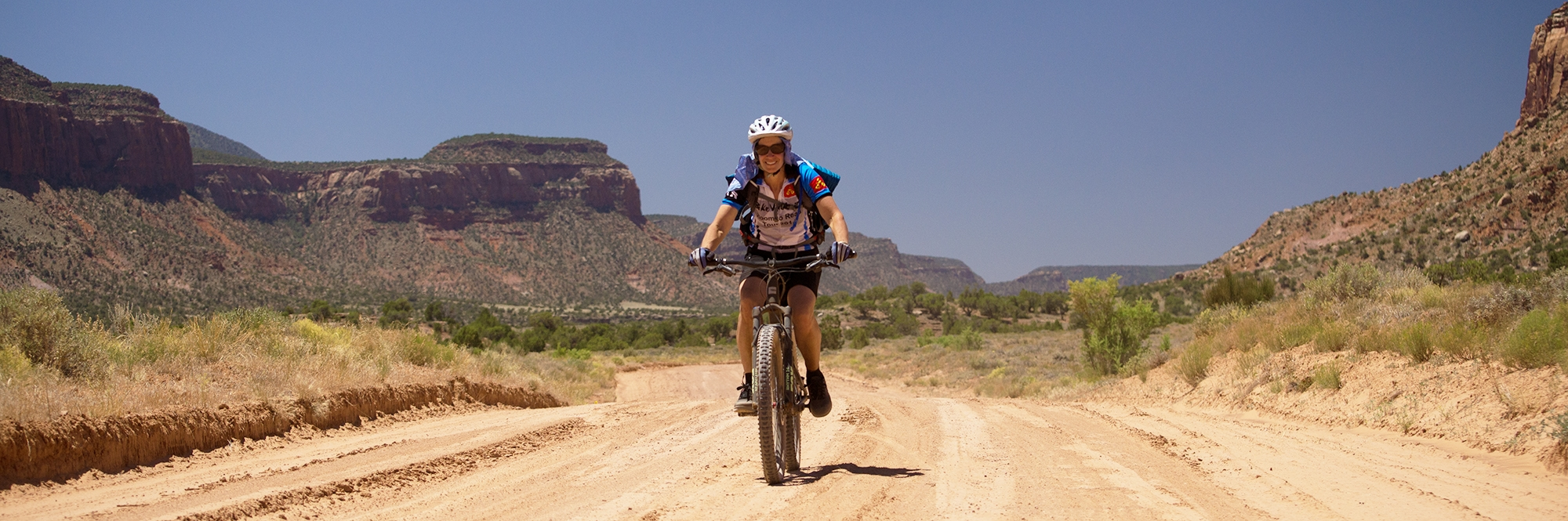 A Bears Ears rider speeds down the final stretch of sandy road leading to Dugout Ranch on Day 3