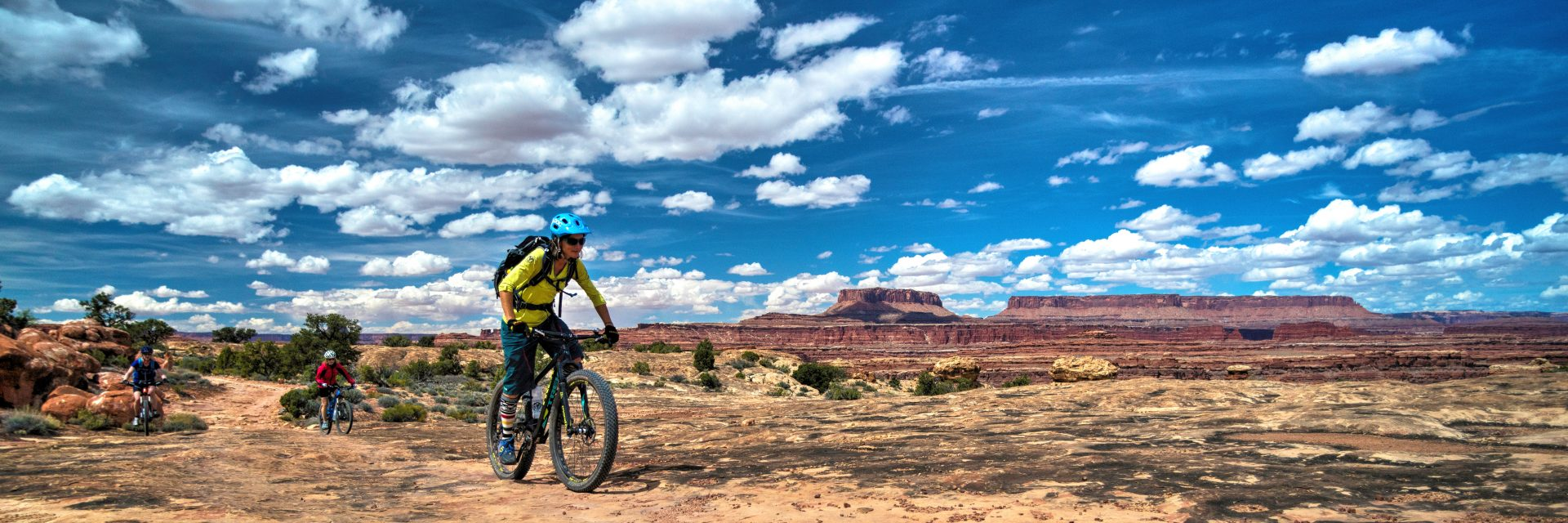 A guide leads a group of mountain bikers on the Colorado River Overlook Road in the Needles District of Canyonlands NP