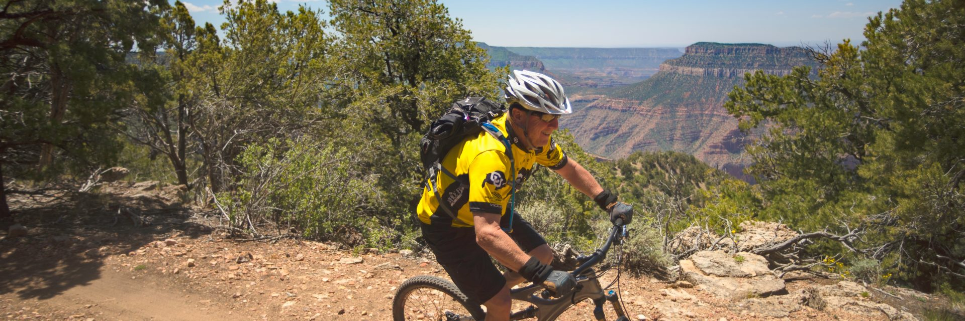 Mountain biking past Locust Point, North Rim of the Grand Canyon