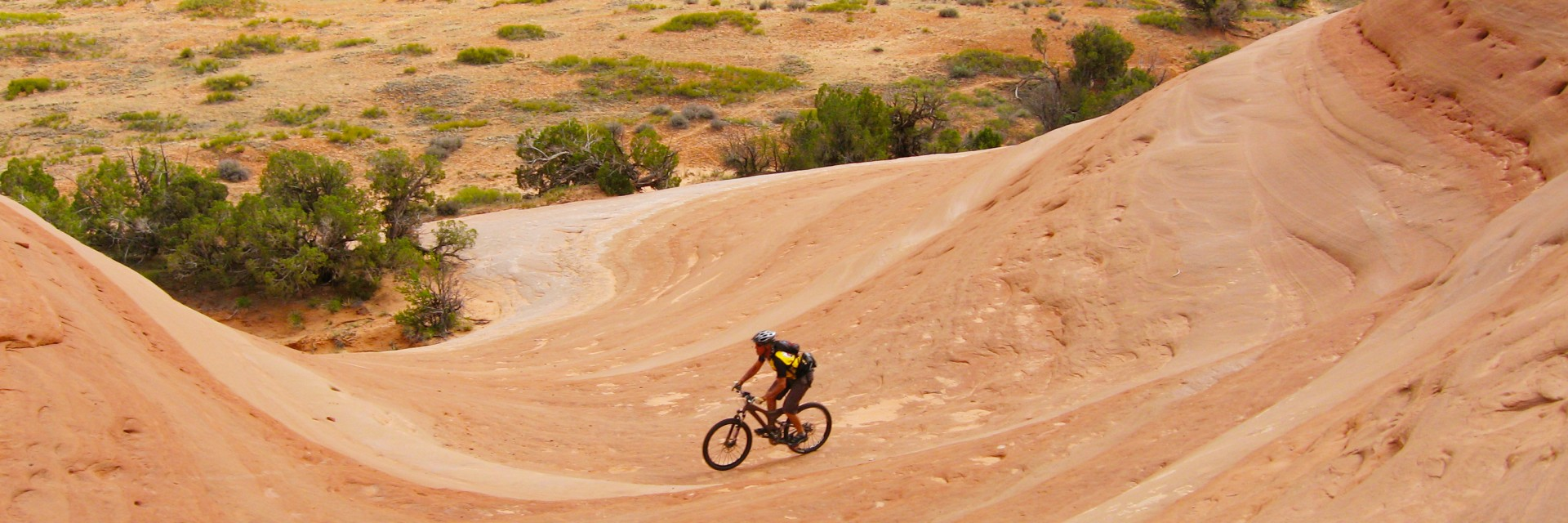 Fun, smooth riding on slickrock rollercoaster section of Amasa Back, Moab UT