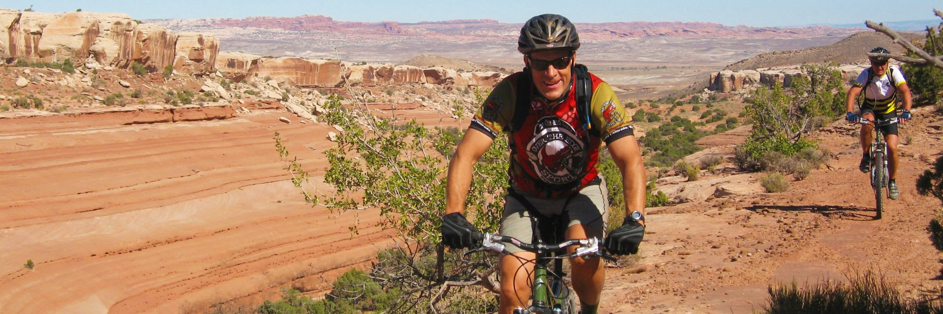 Above the slope on Bartlett Wash, slickrock playground for mountain bikes, near Moab, UT