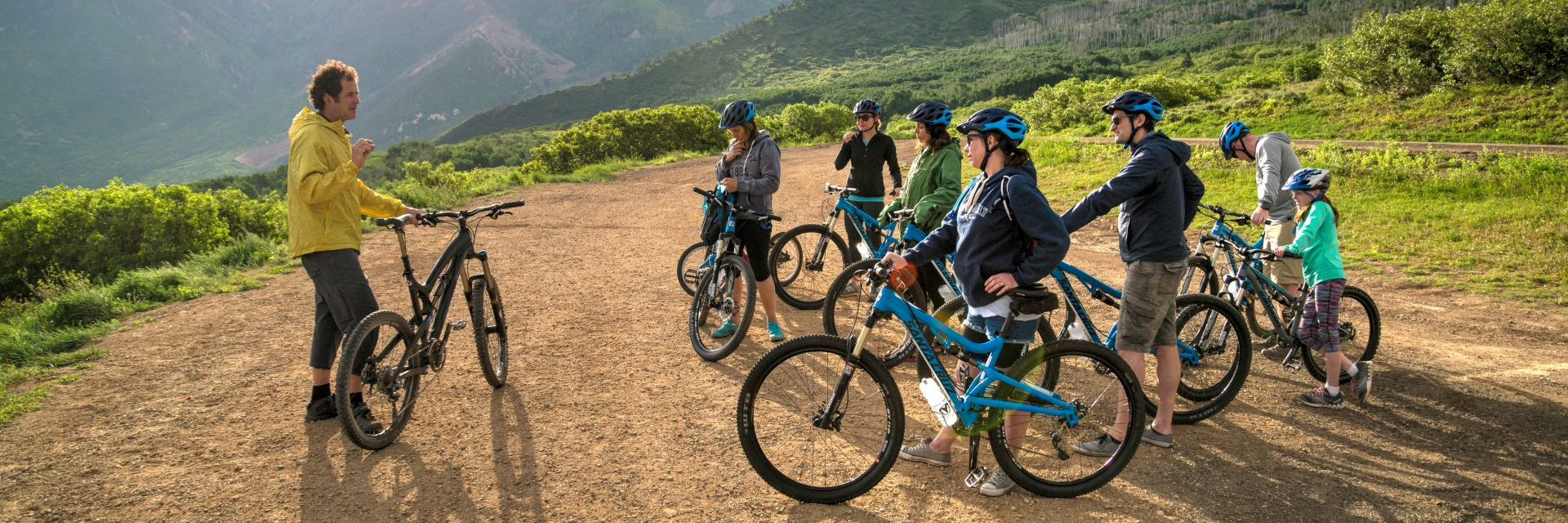A guide gives beginner riders instructions on basic bike operations after breakfast and before launching on the Sunrise Downhill ride