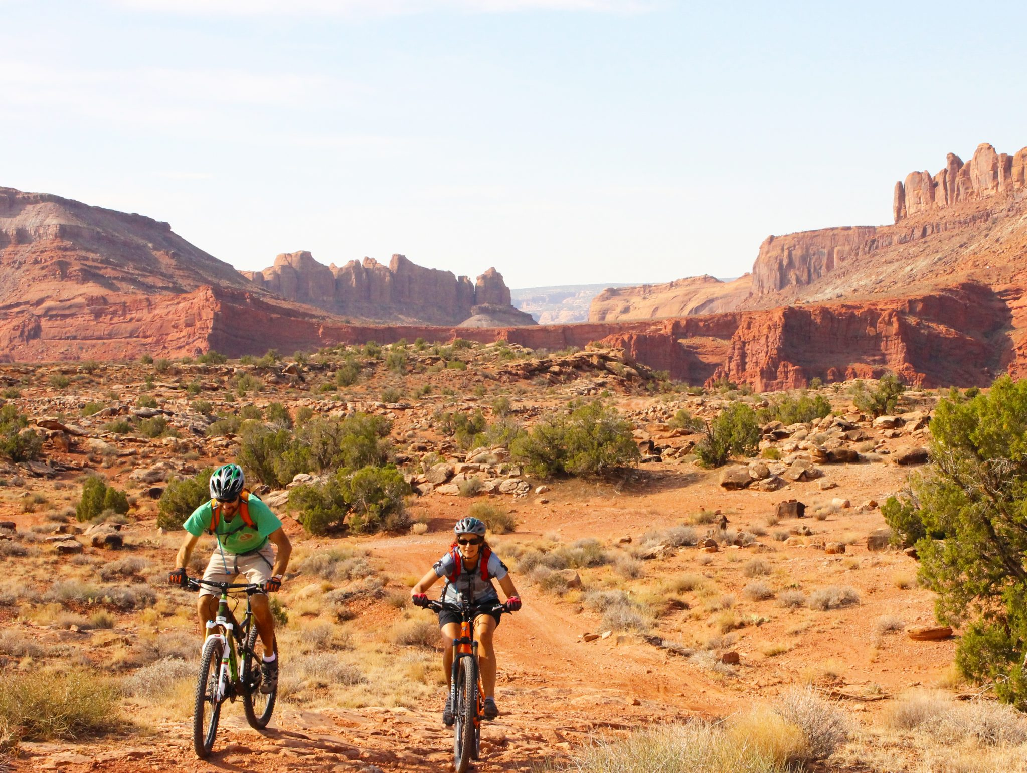 A pair of mountain bikers on Moab Brands Trails, including the Courthouse Loop