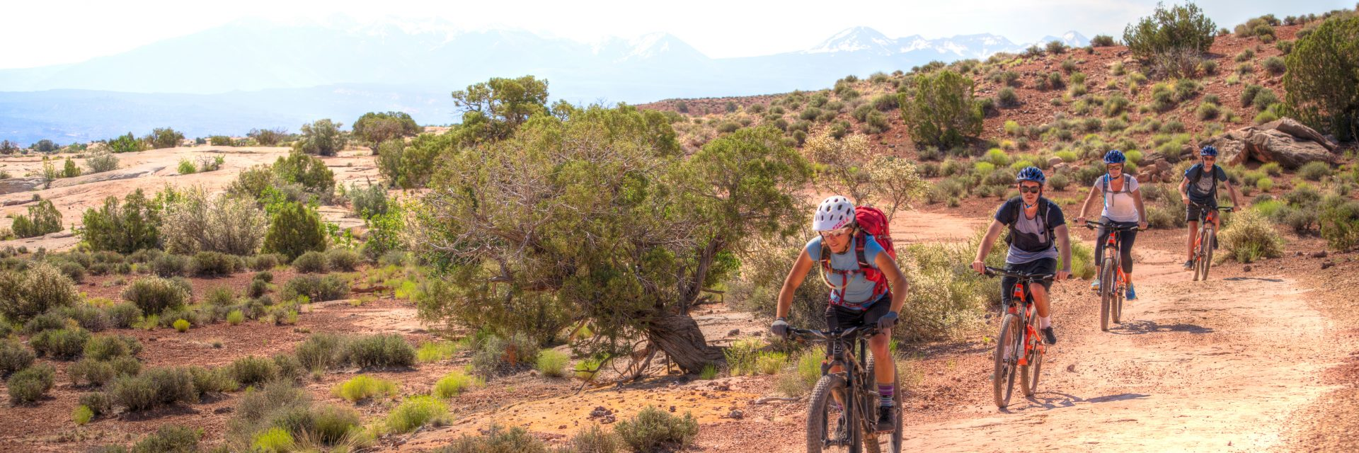 A guide leads mountain bike riders on a guided tour of the Courthouse Loop Trail north of Moab UT
