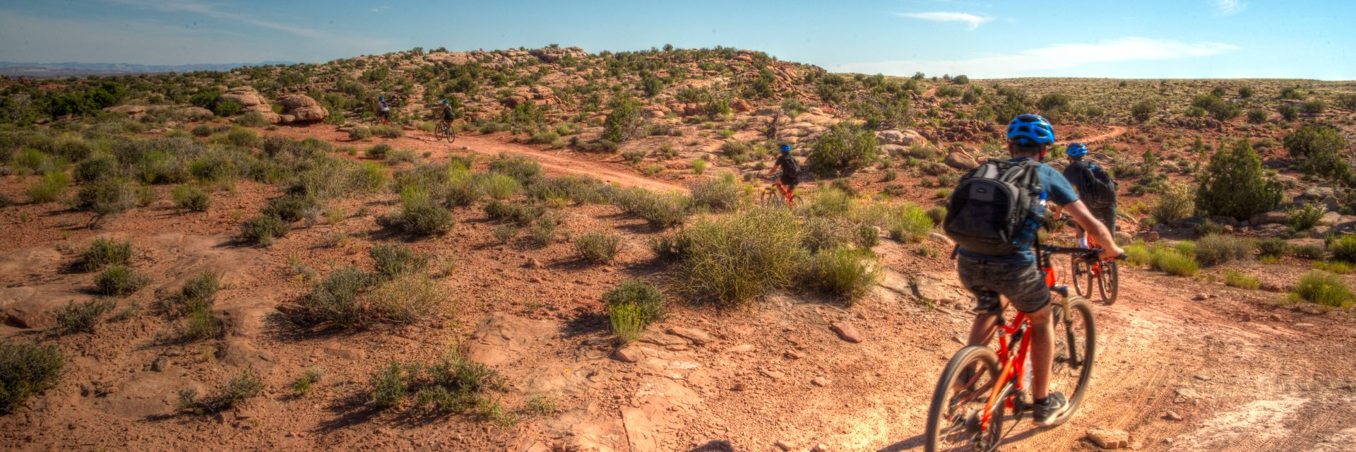 Mountain bikers roll out on the Courthouse Loop at Moab Brands area on a guided tour