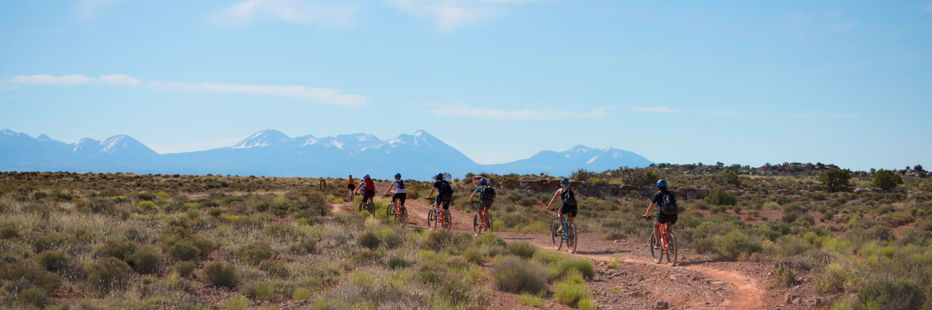 Riders follow their guide up the Courthouse Loop Trail north of Moab UT