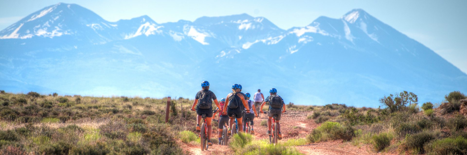Guided mountain bike tour of Courthouse Loop, heading toward Moab