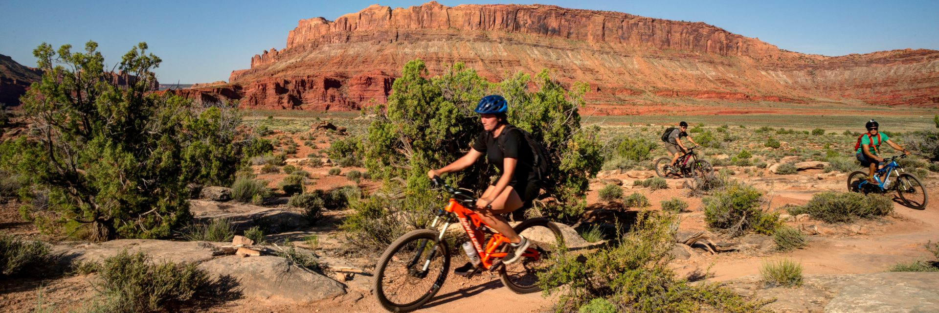 Mountain bikers follow their guide on the beginning of Courthouse Loop Trail