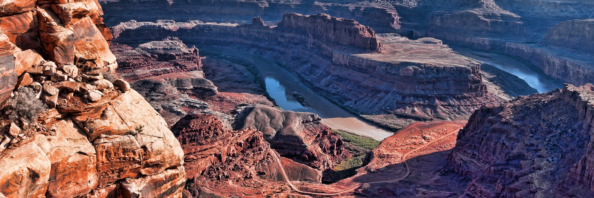 A section of the Potash Road winds toward Thelma and Louise Point above the Colorado River as viewed from Dead Horse Point