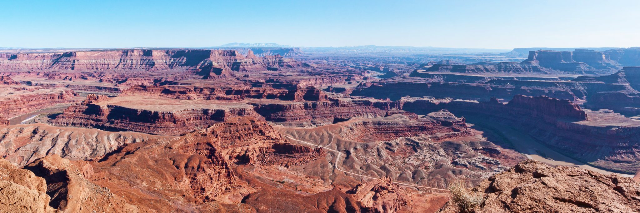 The Canyonlands Full Day guided mountain bike tour rolls along the Potash Road on benches above the Colorado River