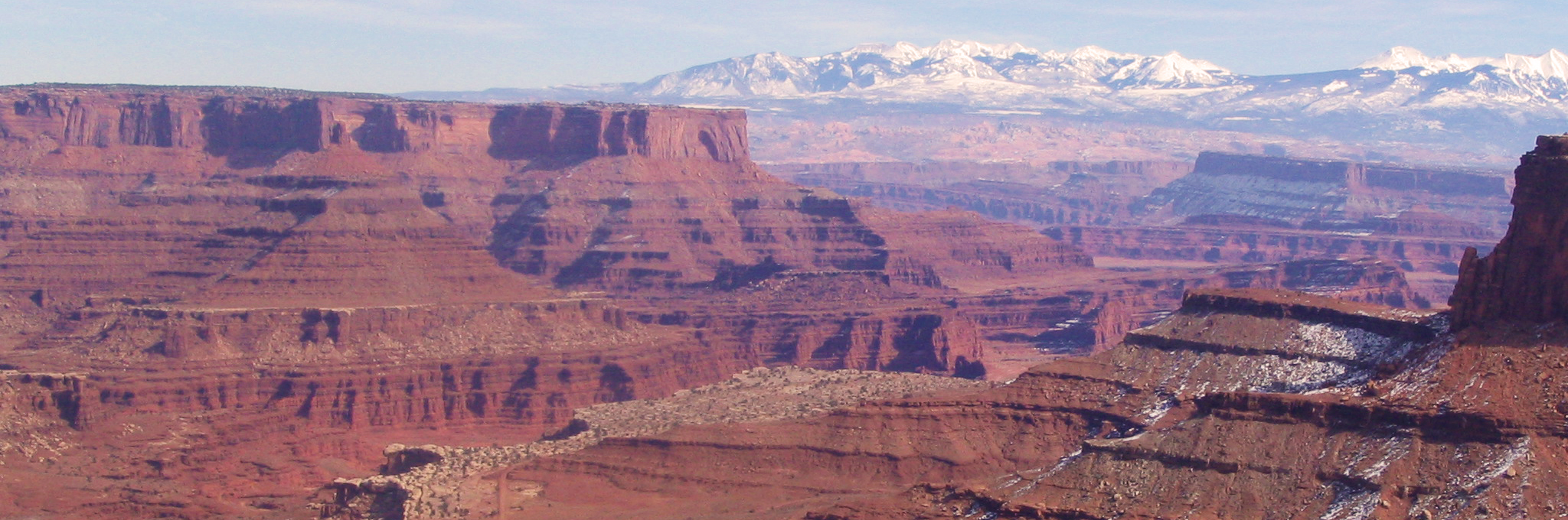 View of the La Sal Mountains above the Shafer Trail, Canyonlands NP full day guided mountain bike tour