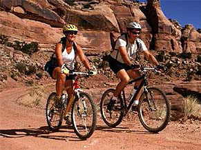 The Canyonlands National Park Full Day guided mountain bike tour is moderate-intermediate doubletrack riding
