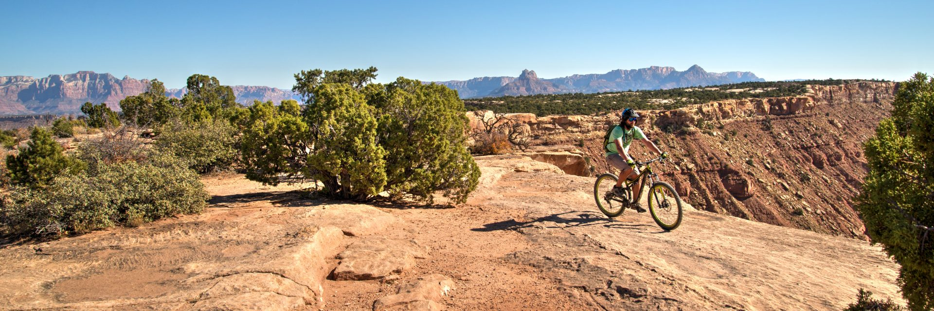 Biker arrives at the South Point on Gooseberry Mesa during guided mountain bike tour