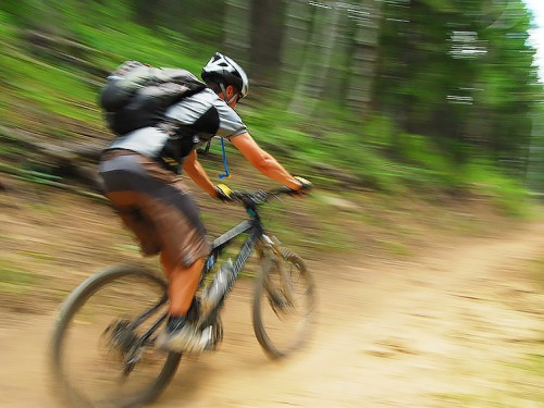 Rider flies along a singletrack section of the Durango Intermediate guided mountain bike tour