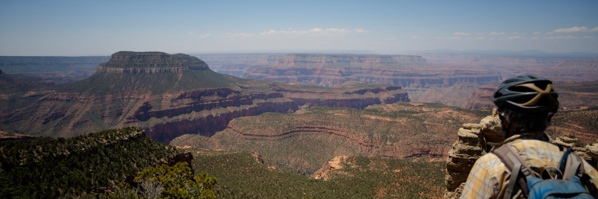 Mountain bikers stop at Fence Point, North Rim of the Grand Canyon on guided tour