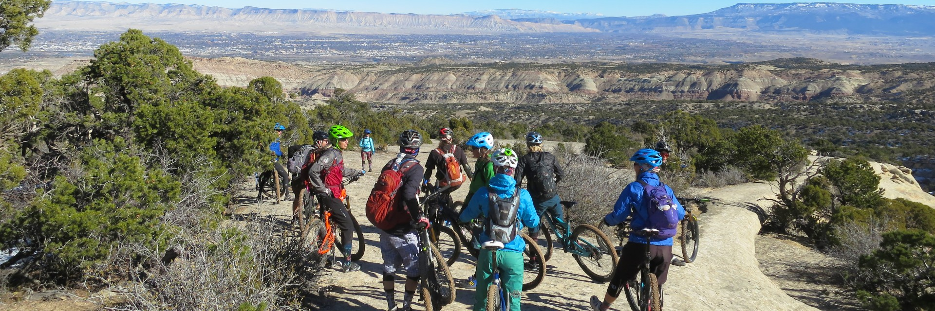Rim Tours staff explore the slickrock mountain bike riding above Fruita, CO during late fall holiday