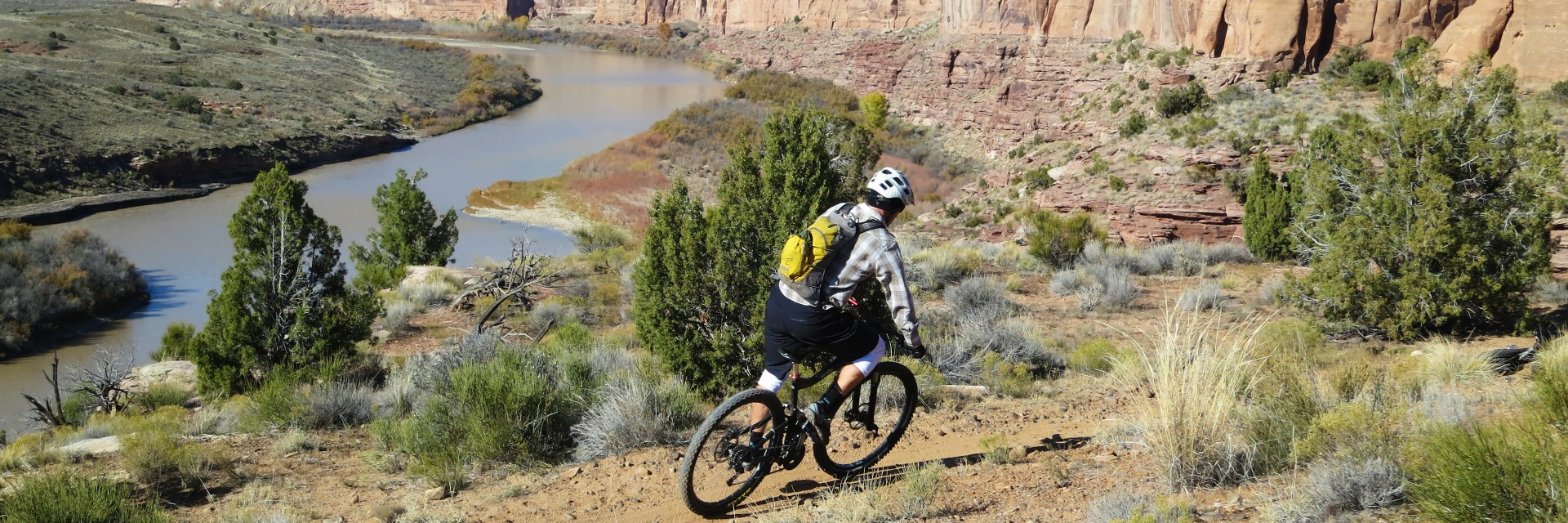 A rider speeds down a winding section on the Kokopelli Singletrack guided mountain bike tour