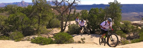 Technical challenges cause some mountain bike riders to walk sections of the Gooseberry Mesa guided tour