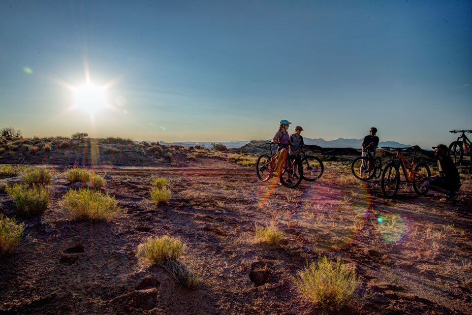 Instruction kneeling before Desert Sunrise ride
