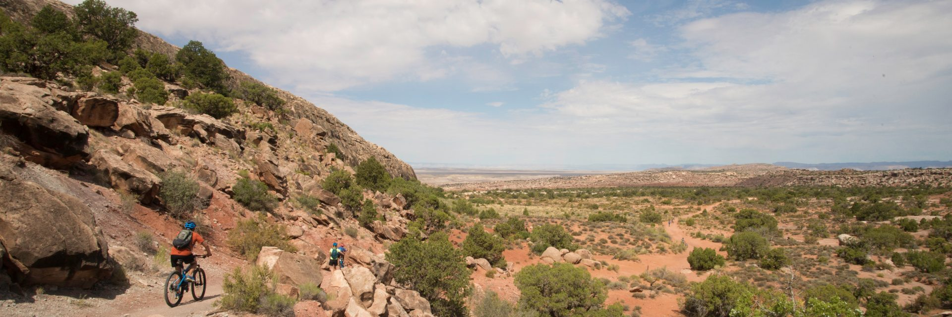 Back from the hike into Arches National Park, bikers descend the singletrack section of Klondike Bluff Trail, Moab UT