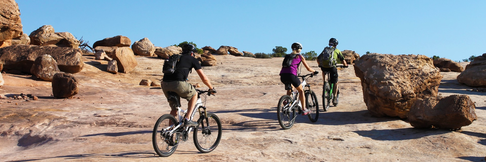 Visitors experience a guided mountain bike tour on the Klondike Bluff Trail north of Moab UT