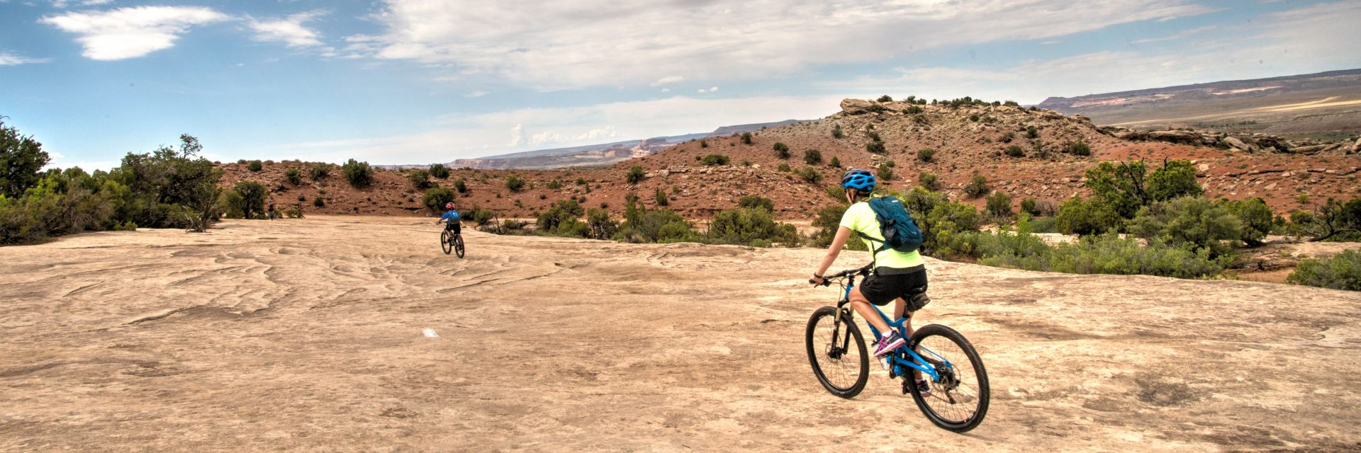 Klondike Bluff Trail includes a long section of smooth slickrock, moderate mountain bike guided tour
