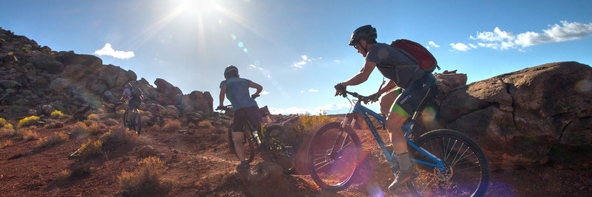 A guide leads his group of mountain bikers up a climb at the beginning of Borderline Trail in Klonzo Area north of Moab, UT