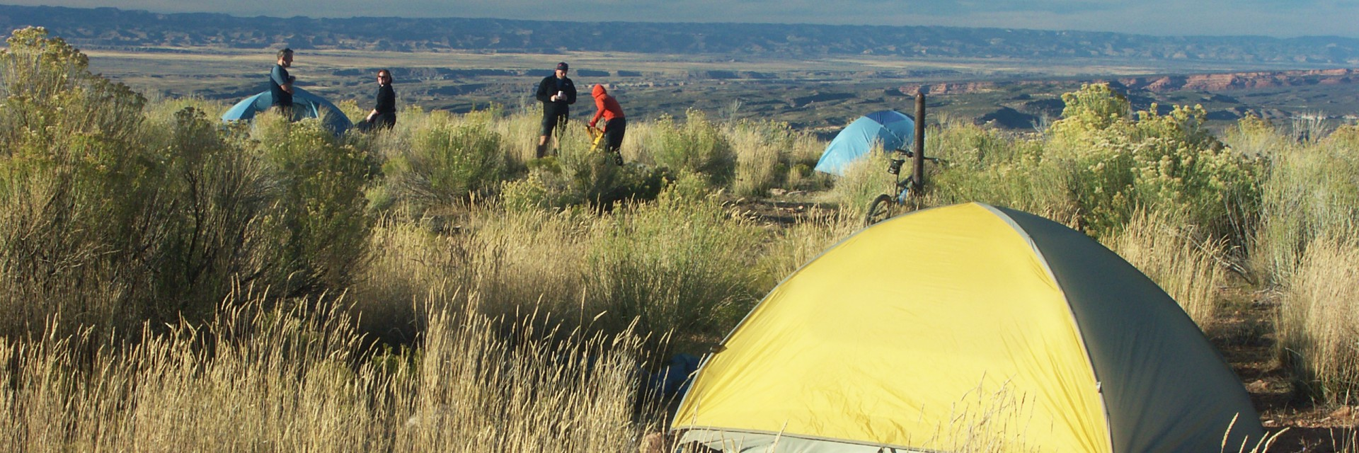 Guides and guests setting up camp on the Kokopelli Trail guided mountain bike tour