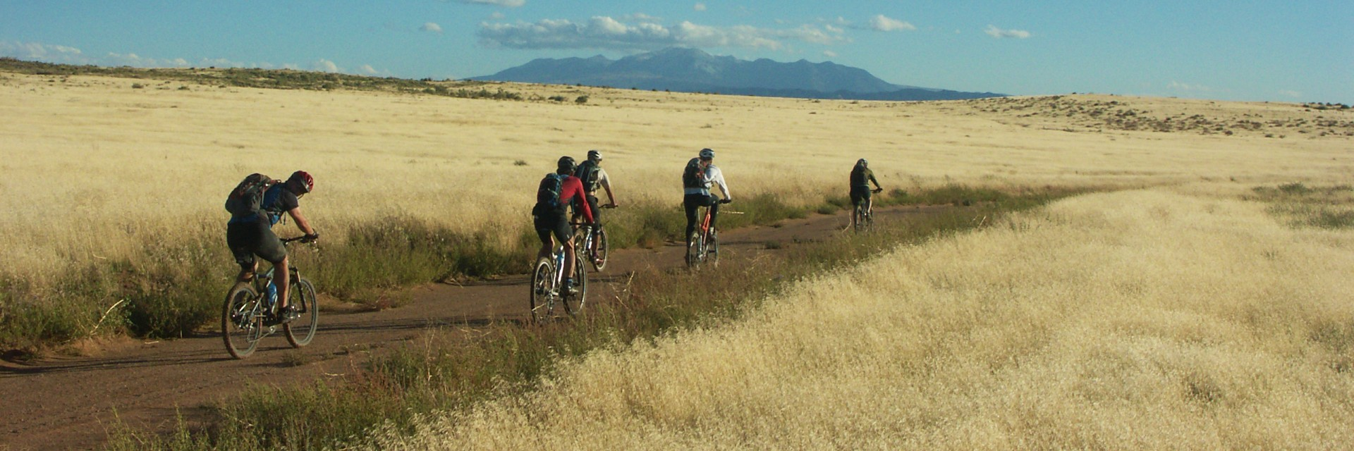 Riders on the Kokopelli Trail 5-day guided mountain bike tour from Loma CO to Moab UT head across the Cisco desert