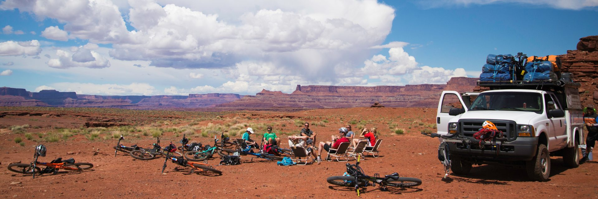 Lunch stop at an old drill pad prior to the descent into Lockhart Basin during the 4-day Needles to Moab guided mountain bike tour