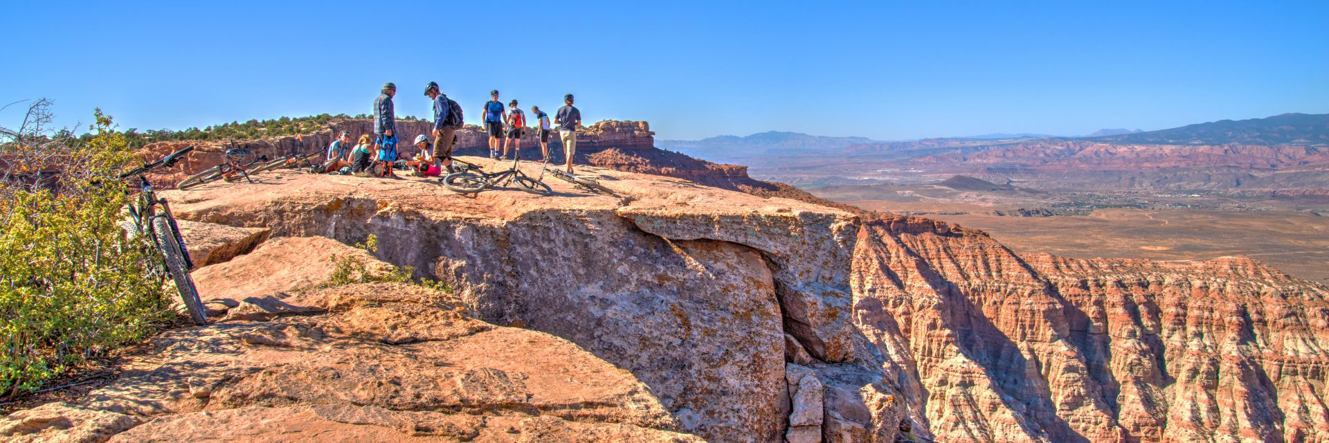 Mountain bike riders regroup at the South Point lunch spot on Gooseberry Mesa during guided tour