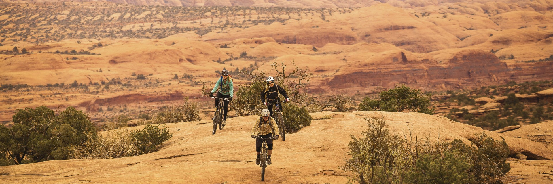 Above Bull Canyon rim, crossing slickrock, Magnificent 7 singletrack, Moab UT