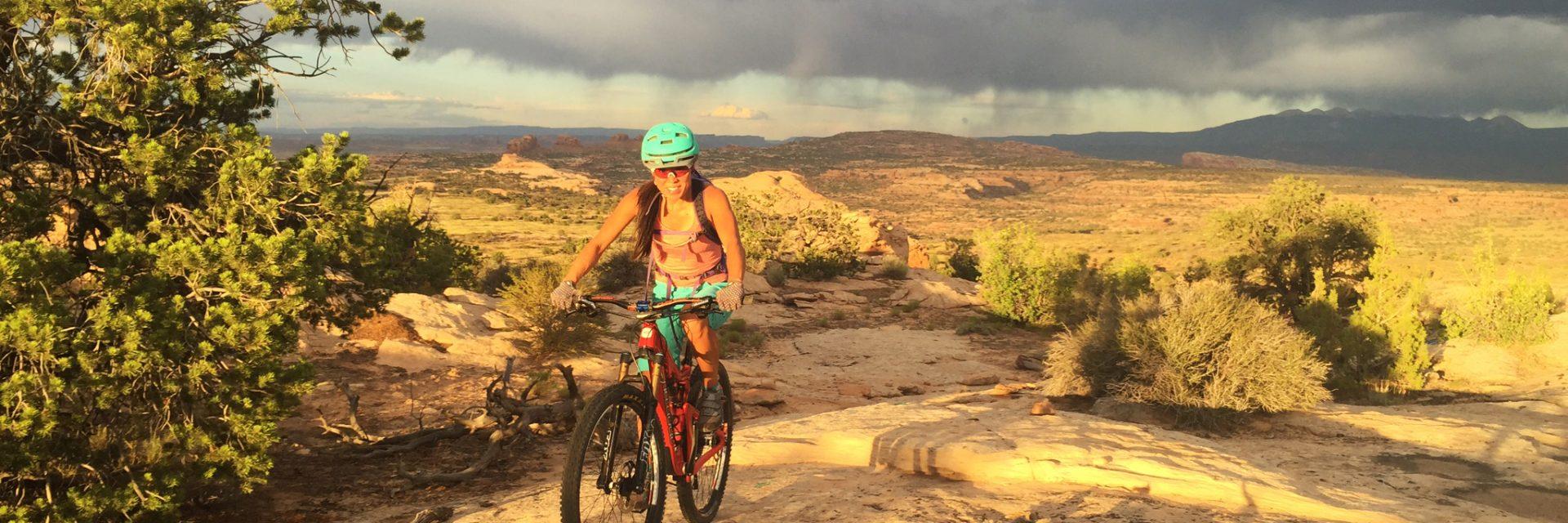 Laruen on Rocky Tops, Navajo Rocks, La Sal Mountains background