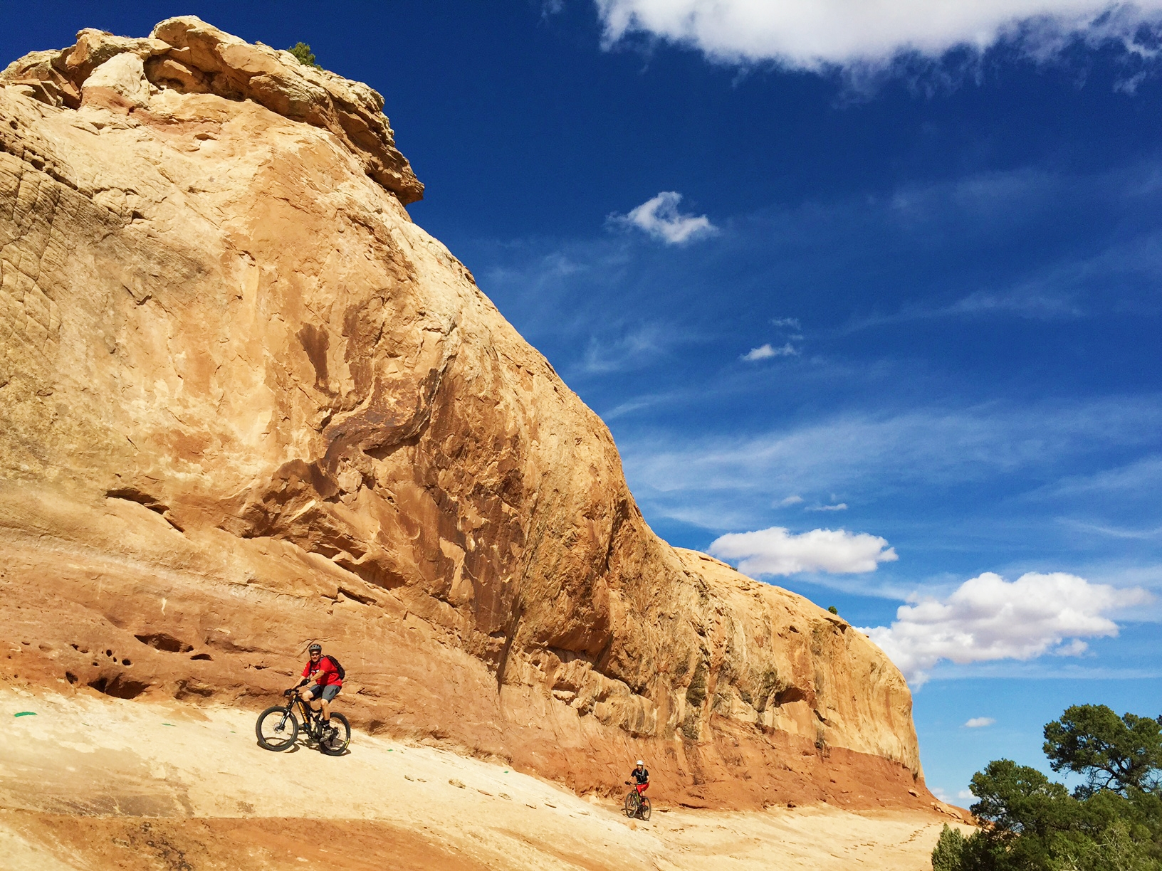 High angle slickrock is just one of the many challenges on the Rocky Tops section of Navajo Rocks Trail north of Moab