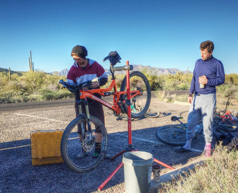 Rim Tours guide, Reid Bakken, tunes up a bike during an early spring guided mountain bike tour in Arizona's Sonoran Desert.