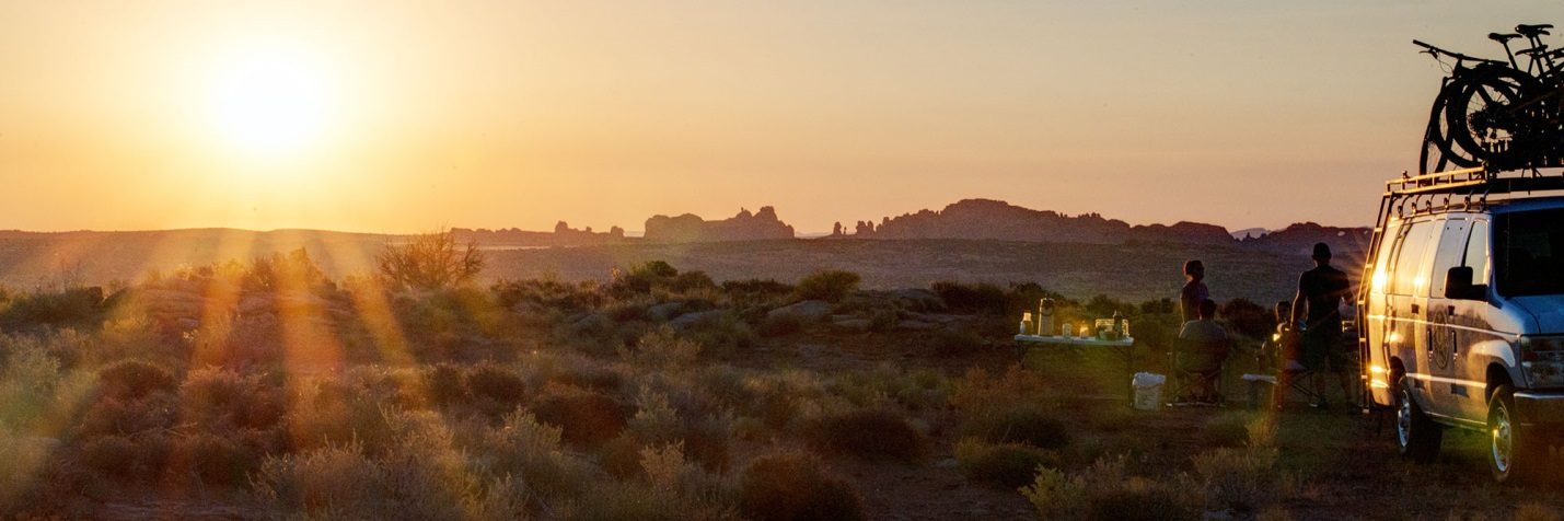 Desert Sunrise over Arches Nationa Park with breakfast and bikes