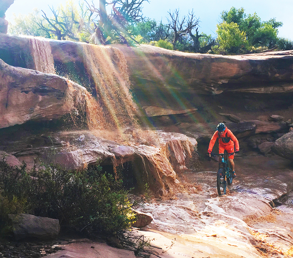 Moab Fall Mountain Biker Riding through the falls