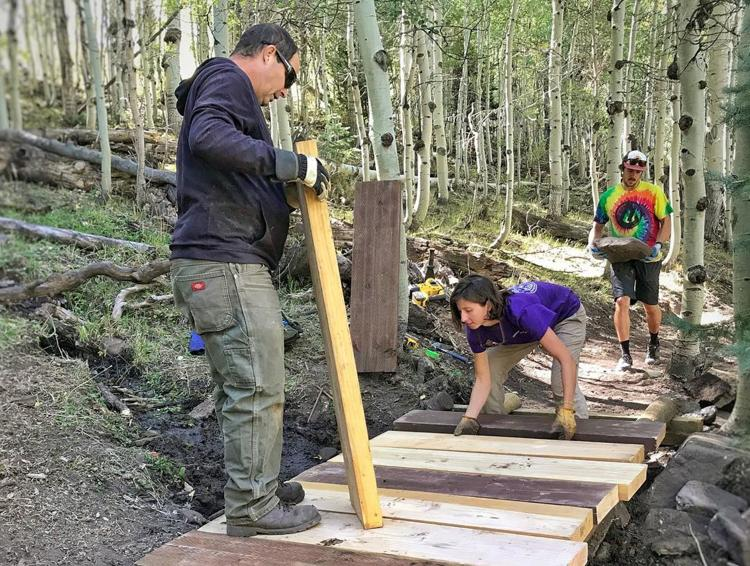 Trail Mix volunteers at work on an upper section of The Whole Enchilada Trail