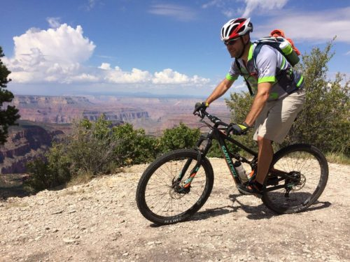 A mountain bike rider on the Rainbow Rim Trail section of the North Rim of the Grand Canyon