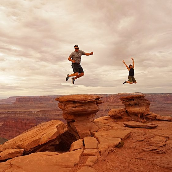 Sol Jorn blog authors Matt and Anna jumping with joy at Dead Horse Point